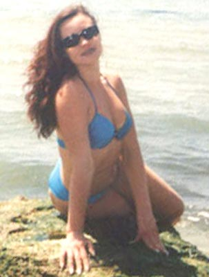 Serious woman Natal'ya in bikini from Vinnitsa (Ukraine), 41 yo, hair color brunette